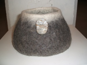 Natural wool, stone and linen vessel