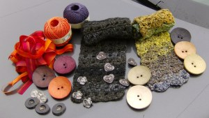 Buttons, ribbons, yarn and cowls